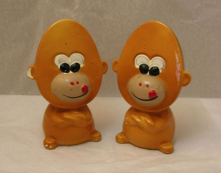 Flat faced monkey (orangutan?). salt & pepper shakers in good, used condition. Their heads are shaped like half of a hard boiled egg. Both have their tongues out and arms crossed. The pepper shaker has a chip on one ear and both have paint scrapes, but still cute. | eBay!