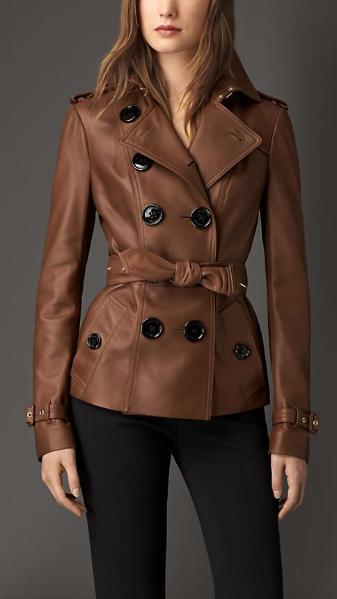 Burberry Dark Umber Brown Leather Trench Jacket - A short trench jacket in soft leather.  The design is tailored to the body, with a tapered waist and slim set-in sleeves.  Heritage features include epaulettes, a gun flap, belted cuffs and a storm shield.  Discover the women's outerwear collection at Burberry.com