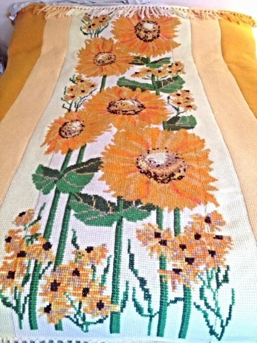 Absolutely beautiful knit afghan bedspread with cross stitch details in the design of a sunflower garden.  This blanket is sunny and cheerful, it will brighten up any room.  Beautiful hand made yarn textile.  A lot of work went into this!