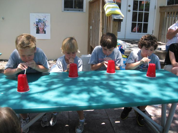 Cup race..Using a straw, see who can blow a series of plastic cups off the end of the table first.