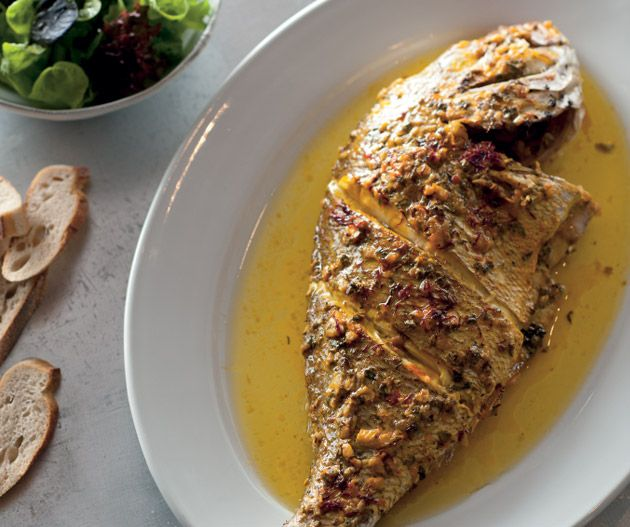 Whole baked snapper from the Sydney Seafood School Cookbook by Roberta Muir and Sydney Seafood School || Photography by Alan Benson