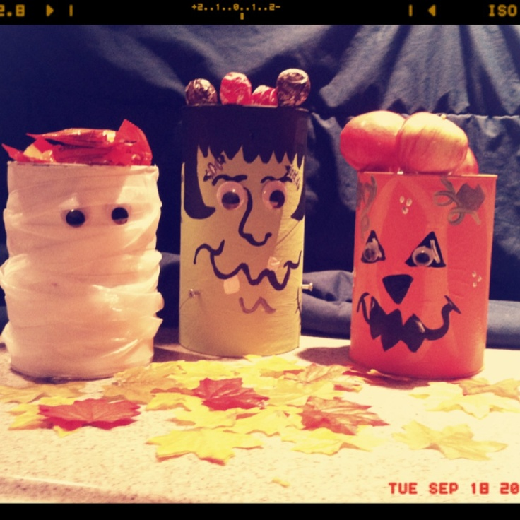 Our Halloween candy jars made out of old oatmeal and baby formula cans.