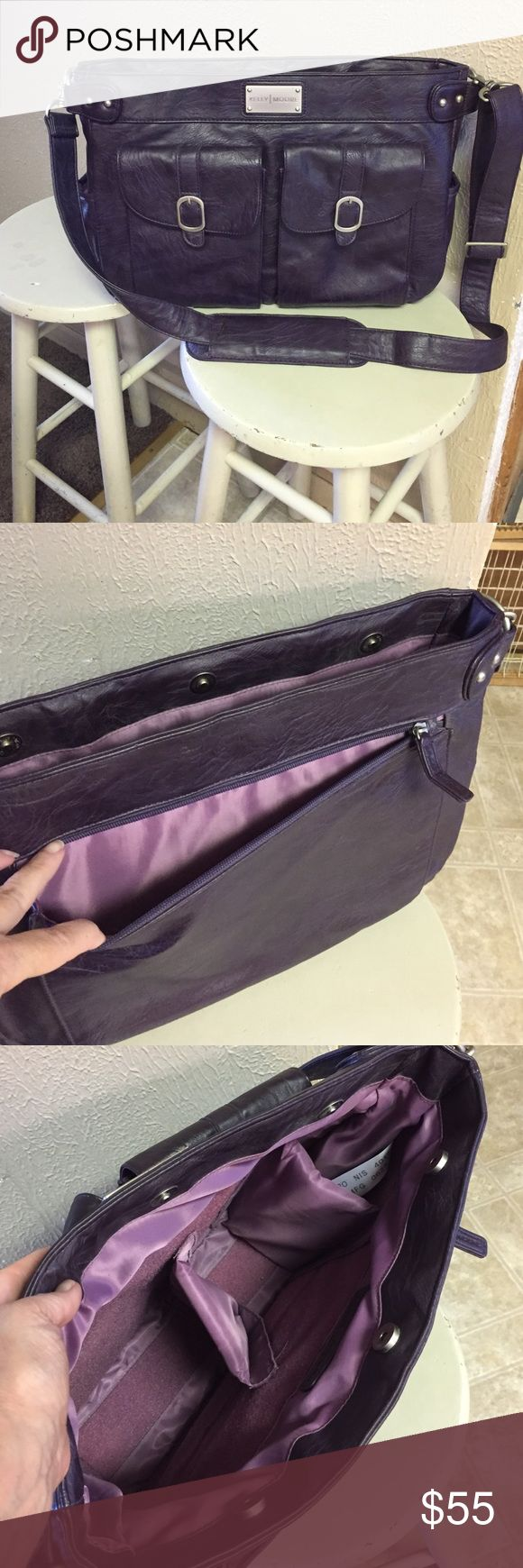 Kelly Moore Camera Bag Kelly Moore Camera Bag in purple. Has 2 pockets on front, 1 long zip pocket on back & slip pockets on each end. Has 2 Velcro dividers to separate your camera equipment. Bag is also padded to protect you camera & lenses.  Comes with padded shoulder strap. 15(w) 11(h) 4(w) Gently used. Kelly Moore Bags Shoulder Bags