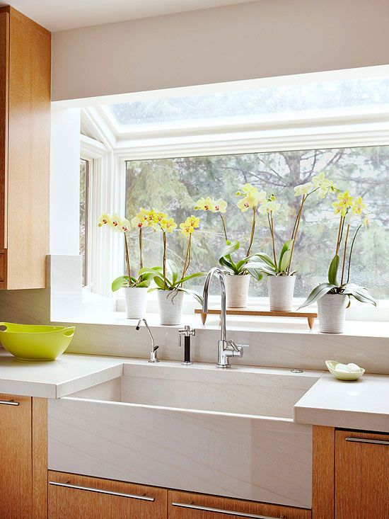 Kitchen Sink with a Great View--like the greenhouse-style window and farmhouse sink