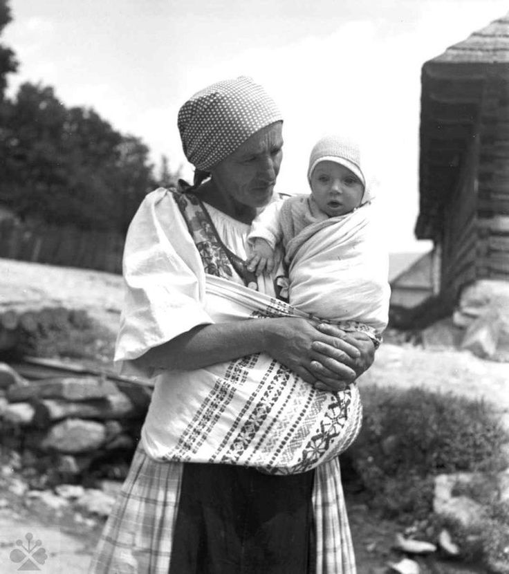 Slovak mother with shawl style baby carrier.