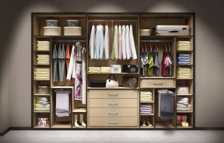 Vestidores y closets de estilo moderno por AstiDkora