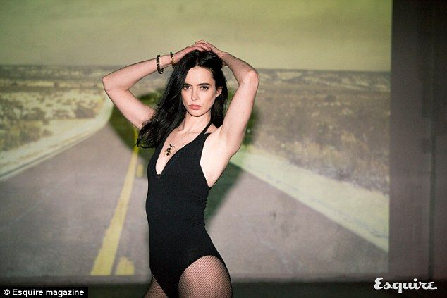 Smoking hot: The actress looks stunning in a black one-piece and fishnet stockings for a steamy photo shoot