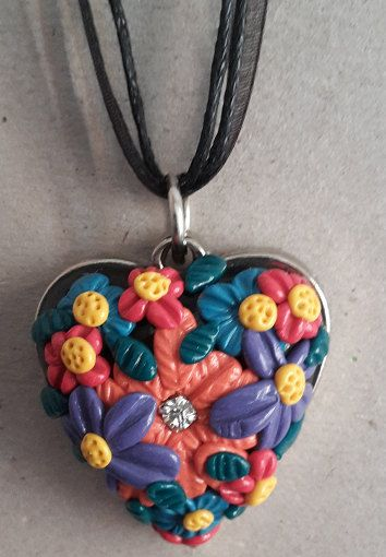 Check out this item in my Etsy shop https://www.etsy.com/listing/236964316/flowers-polymer-clay-heart-pendant