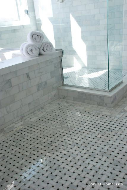 beautiful marble bathroom with glass shower.  love the floor.  would swap the marble subway tile for white subway tile.