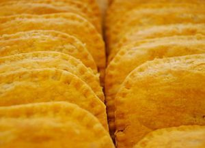 Tasty Jamaican Patties: A Jamaican patty is a pastry that contains various fillings and spices baked inside a flaky shell, often tinted golden yellow with an egg yolk mixture
