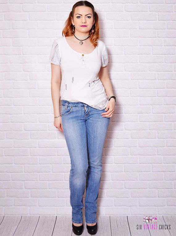 Vintage blue low rise jeans made by Lee.  Please check measurements to avoid problems with the size. Make sure you double the measurements where shown (*2):  Label size: S/36 W27 L33 Total lenght: 109.5 cm / 43.25 inches Waist: 35 cm *2 / 13.75 inches *2 Hips: 44.5 cm *2 / 17.5 inches *2 Thigh: 22.5 cm / 8.75 inches *2 Inseam: 85.5 cm / 33.75 inches Rise: 22 cm *2 / 8.75 inches  Label: Lee Condition: very good vintage Colors: blue Circa: 90s Fabric: 98.5% Co...