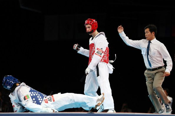 Martin Stamper Photos Photos - Rohullah Nikpah (L) of Afghanistan competes against Martin Stamper (R) of Great Britain during the Men's-68kg Taekwondo bronze medal finals on Day 13 of the London 2012 Olympic Games at ExCeL on August 9, 2012 in London, England. - Olympics Day 13 - Taekwondo