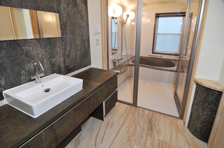 Slate veneer tile bathroom vanity, bathroom flooring and bathroom wall cladding. Slate and stone bathrooms.