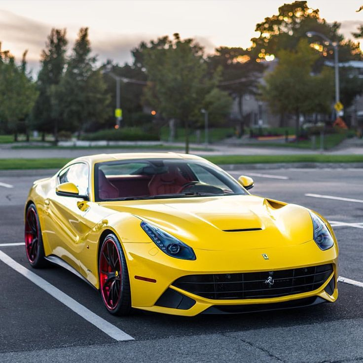Ferrari F12 Berlinetta painted in Giallo Modena w/ Corse Werk wheels   Photo taken by: @zachbrehl on Instagram (@ansel.liu on Instagram is the owner of the car)