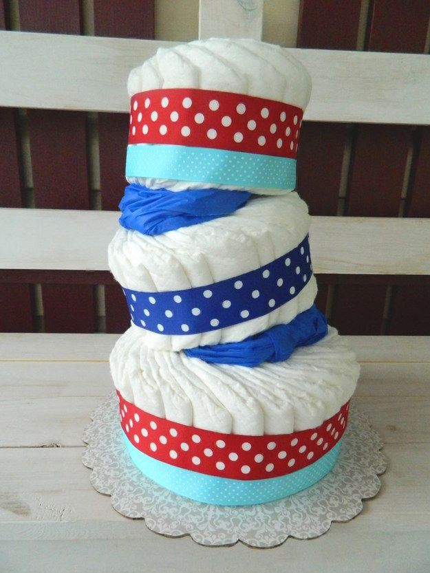 A topsy-turvy cake wrapped in fun, colorful ribbon. | 19 Stunning Diaper Cakes Anyone Can Make