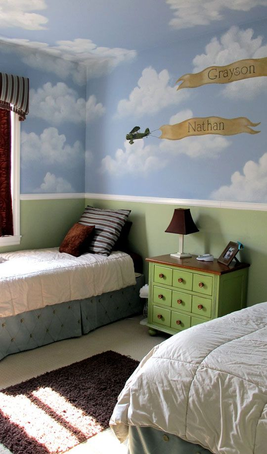 Love the clouds on upper walls & ceiling & planes with banners with kids' names.