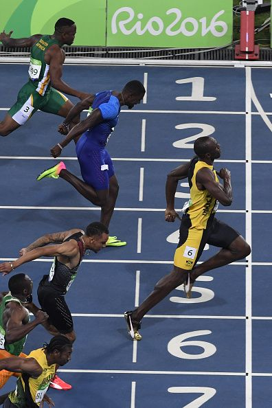 Jamaica's Usain Bolt crosses the finish line ahead of USA's Justin Gatlin to win…