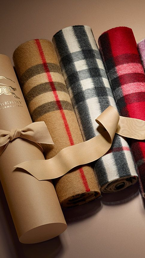 Cashmere scarves woven in Scotland in colourful check designs. Find the perfect gift this festive season at Burberry.com #burberrygifts #christmas