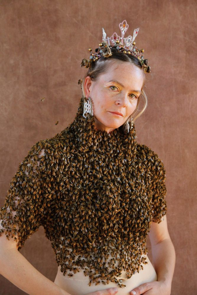 "The Bee Queen Sara Mapelli - Sara Mapelli dances with honeybees. More specifically, she periodically spends two hours covered  in a ""blouse"" of about 12,000 bees, inviting friends and strangers to witness the event, and documents the experience in striking photography and video pieces."