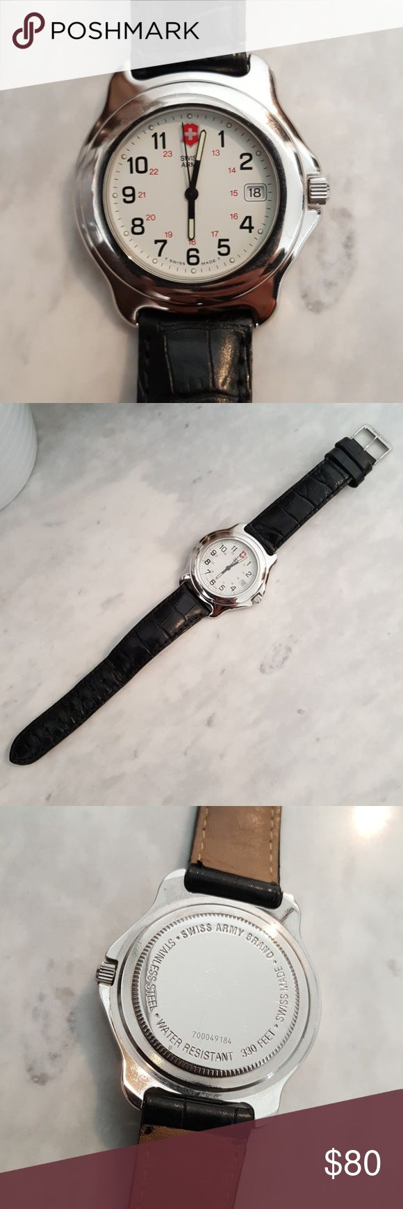 Swiss Army watch Classic Swiss Army watch in excellent condition with its original  German leather strap. It's a great classic everyday watch. Wear it to the office or pair it with a feminine dress to add an edge. It's a men's watch but can be worn as a boyfriend watch by the ladies. Needs new battery. Swiss Army Accessories Watches
