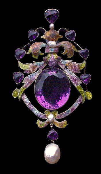 ARTS & CRAFTS The Heart Pendant A large & important Jewel in the Pre-Raphaelite style Gilded silver, amethyst, enamel & pearl Length: 11.2cm (4.4 in) Width: 5.7 cm (2.2 in) Minor enamel repair English. Circa 1890 This jewel was probably a betrothal gift. Original fitted, case the silk marked: 'W. Phillips, Antique Jeweller, 492 & 494, Oxford St.,W.' Literature: cf. Pre-Raphaelite to Arts & Crafts Jewellery Charlotte Gere & Geoffrey C. Munn, 1996.