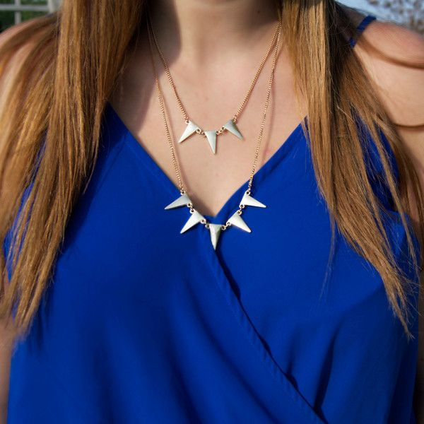 A subtle statement necklace - featuring spikes that are cute, yet classy.