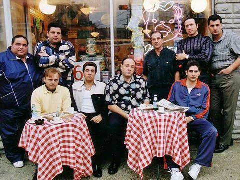 "Back row, standing (l to r) - Joseph R. Gannascoli (Vito Spatafore),  Steven R. Schirripa (Bobby ""Bacala"" Baccalieri),  Dan Grimaldi (Patsy Parisi),  Federico Castelluccio (Furio Giunta),  Robert Funaro (Eugene Pontecorvo) Front row, sitting (l to r) -  Joe Pantoliano (Ralph Cifaretto), Steven Van Zandt (Silvio Dante), James Gandolfini (Tony Soprano), Michael Imperioli (Christopher Moltisanti)."