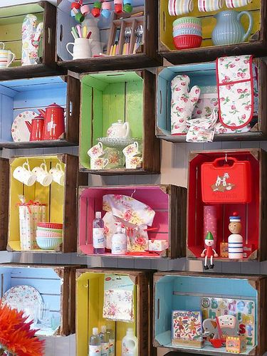 Painted wooden crates - great way to add that POW of color to a display. You could do something similar to a bookcase or an armoire by just taping colored paper up, which would then be easily changed out for the next season.