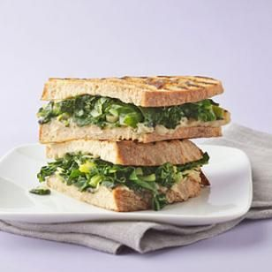 Braised Greens & Cannellini Bean Panina. I need to make this on Ezekial Bread during the spring time!!!