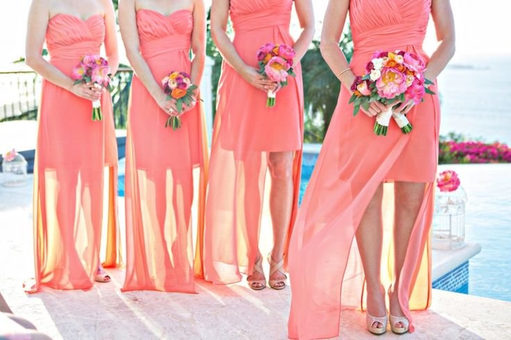 Colorful coral bridesmaids dresses for Caribbean wedding. Bright flowers. Photo by Joy Marie Studios