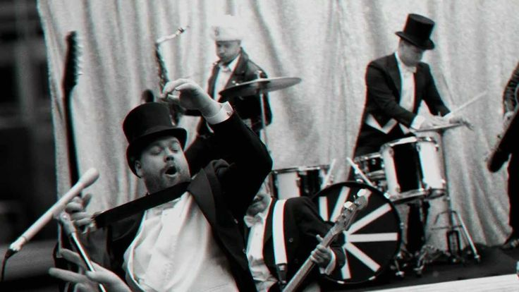 """The Hives - """"Go Right Ahead"""" - 'Our god is a sinner, our king is a con/ The room's about to crumble as I burst into song/ Go right ahead!'"""
