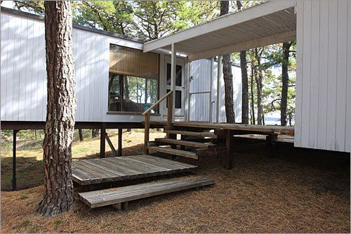 A breezeway separates living sections of the Wellfleet home designed by Marcel Breuer.