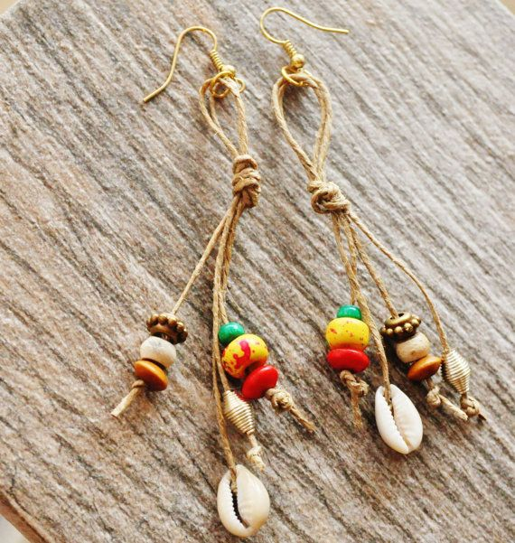 Upcycled Earrings, Tribal Earrings,Rasta Earrings, Cowrie Shell Earrings, Afrocentric Earrings,Tribal Gypsy,Boho Earrings, Boho Hippie,  Island Fun ! These are tribal earrings. 3 inch dangle earrings made with hemp cord, small cowrie shells, wooden beads and a yellow accent bead. Handmade with love and recycled materials. $23.00 USD