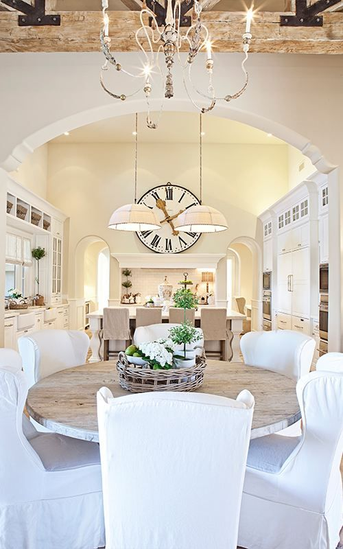 Oh my. *sigh* everything. I love all the white, rustic modern, chippy, hang a huge clock in the middle right there goodness of it all!