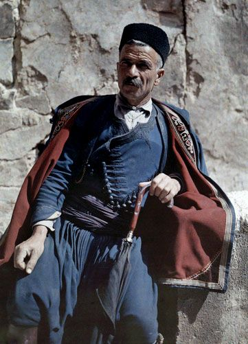 A man poses in the national costume of Crete. Enjoy these beautiful, rare images of Greece in color, captured from the camera of Maynard Owen Williams in the 1920s.