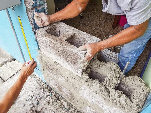 How To Fill Holes In A Cinder Block Wall Cinder Block Walls Cinder Block Cinder Block House