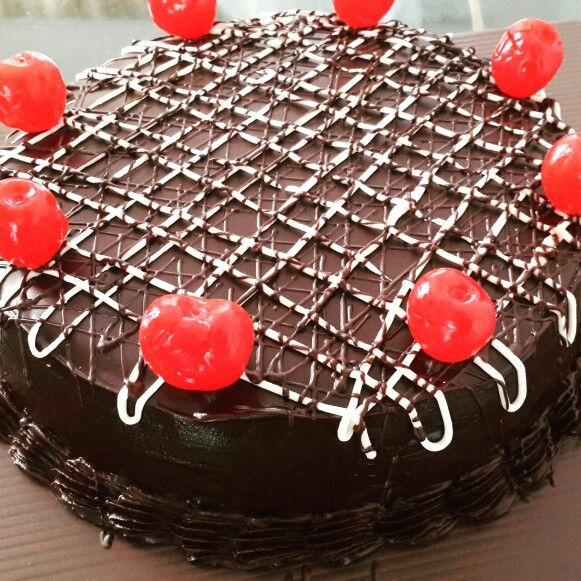 Eggless Chocolate Cake. 18cm diameter round cake frosted in Melted Chocolate Fudge. Homebaked Cakes. A Best Selling Flavour 4 years now.