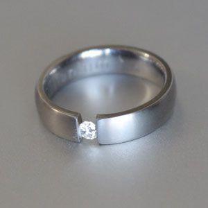 titanium and diamond tension set ring