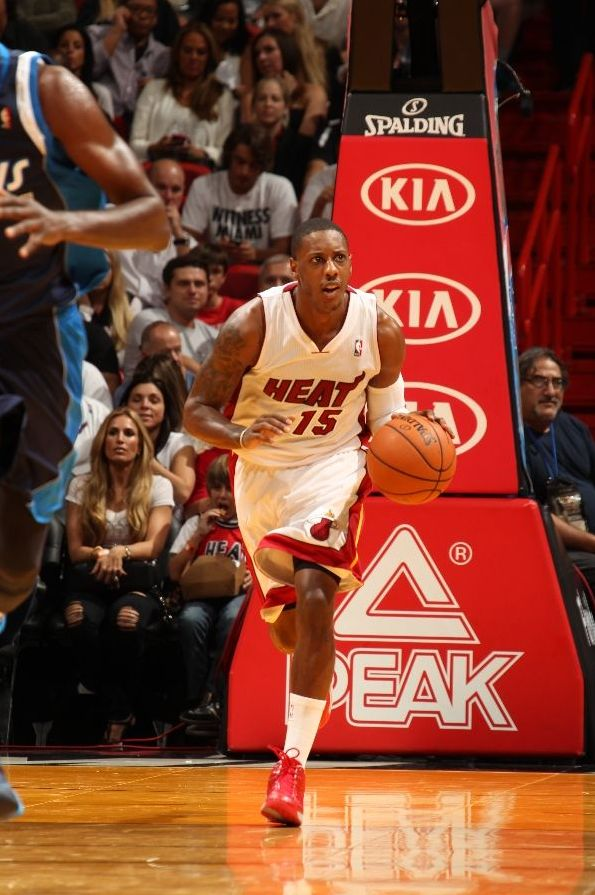 MIAMI, FL - NOVEMBER 15: Mario Chalmers #15 of the Miami Heat moves the ball up-court against the Dallas Mavericks on November 15, 2013 at American Airlines Arena in Miami, Florida.