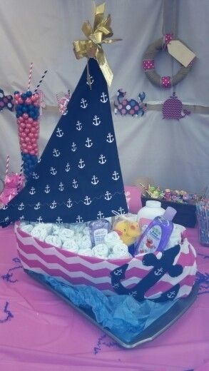Sailboat diaper cake, includes two hand made reversible receiving blankets, 72 size 3 Huggies snug & dry diapers, bath time products, powder and rubber duckies. Can be made with a stuffed animal riding in boat.