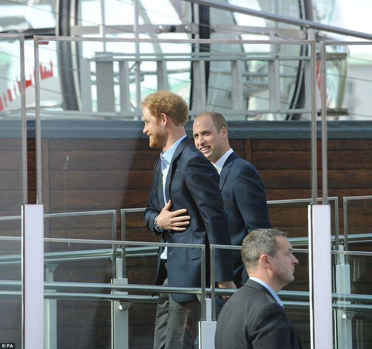 Princes William and Harry share a joke as they prepare to board the London Eye ...