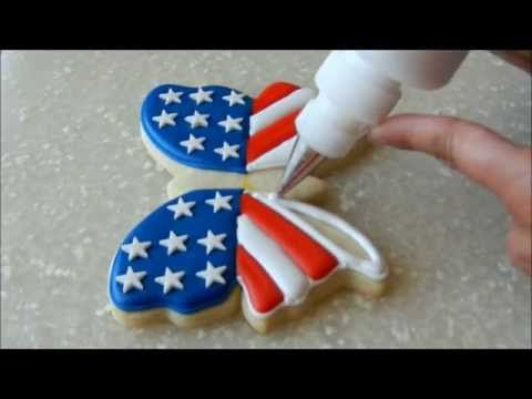 In this video I demonstrate how to make patriotic butterfly cookies. Find me on Facebook http://www.facebook.com/SimplySweetsbyHoneybee Materials used: #2 piping tip and blue piping consistency icing #2 piping tip...