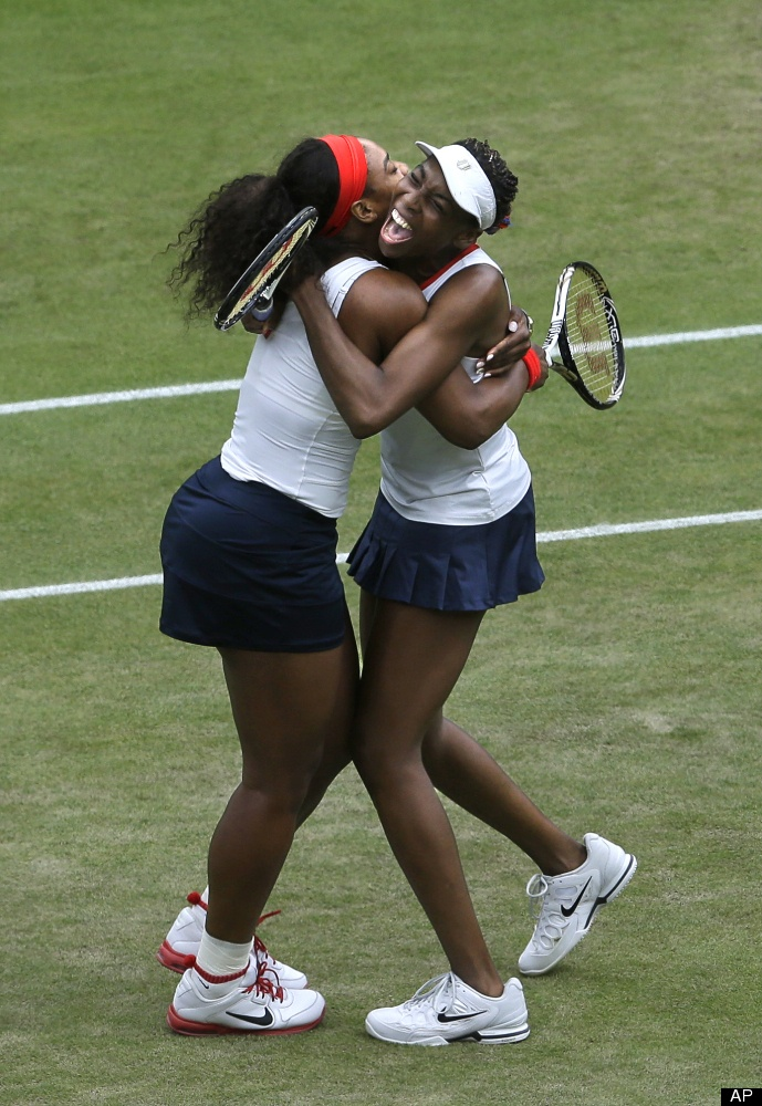 Serena and Venus Williams celebrate after defeating Czech Republic for gold in women's doubles