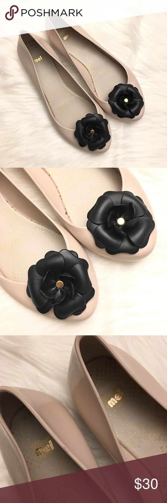 NWOB Beige Black Flower Rubber Ballet Flats | Mel New without box. Size 40. Mel by Melissa flat. Beige/blush color with black flower and gold detail. Mel by Melissa Shoes