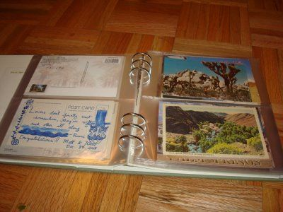 Cool way to keep postcard guestbook post-wedding.