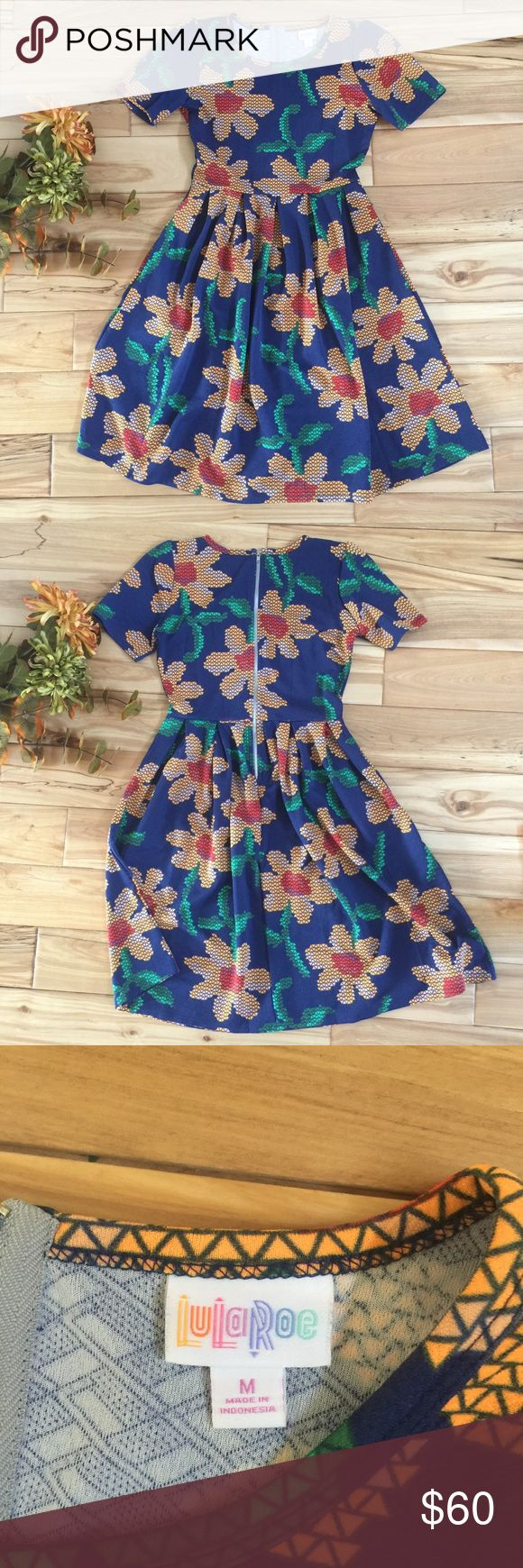 LuLaRoe Amelia Dress - Geometric Flowers - M Worn once for Easter, otherwise new condition. Gorgeous pattern- Just doesn't fit anymore! LuLaRoe Dresses