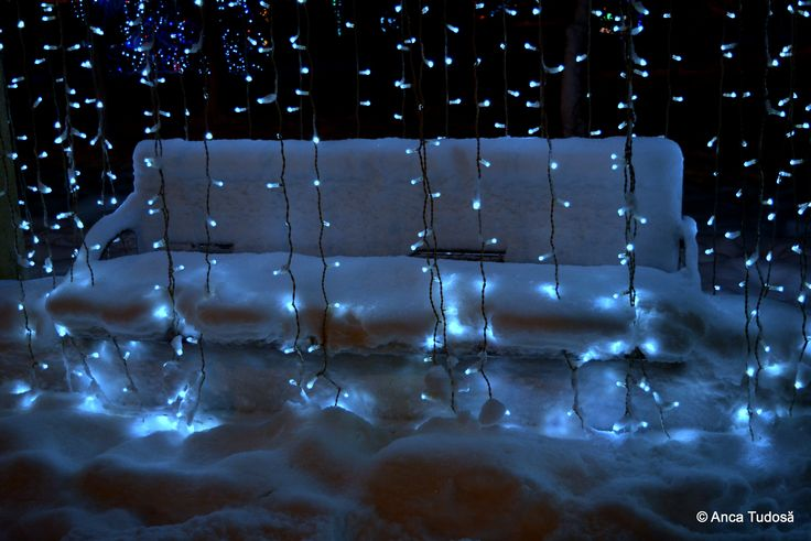 Snow and little lights. It looks cold, but still inviting.