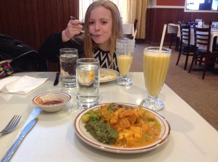 """KK says, """"let's do brunch! But this time at the Indian Food place, I want a mango lasse."""" Goat curry, chicken curry, chicken tikke masala... We have fun! #food #indiapalace #brunch #fargo"""