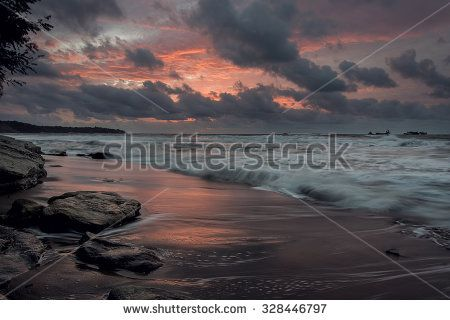 Dark moody sunrise at the beach landscape seascape