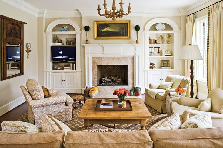 Asymmetrical arrangements can be intimidating, but formal symmetry is easy to pull off and adds a calm balance to a room. The simple arrangement above this fireplace is clean and elegant. See this Formal Nashville Home